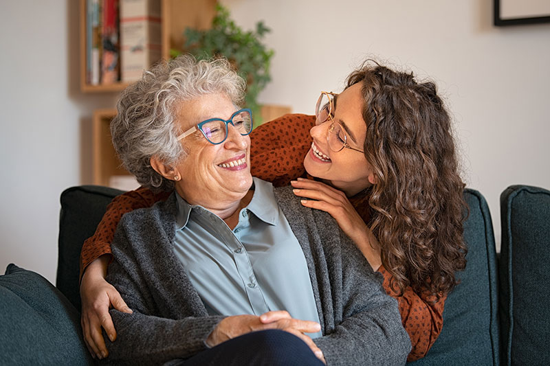 Mature woman and daugther smiling